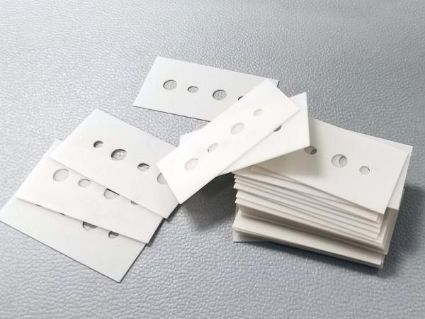 Aluminum nitride ceramic laser processing